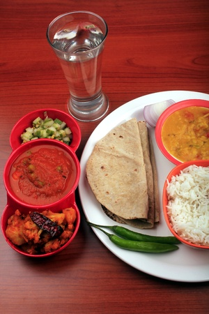 Indian food with chapatti, rice and curries photo