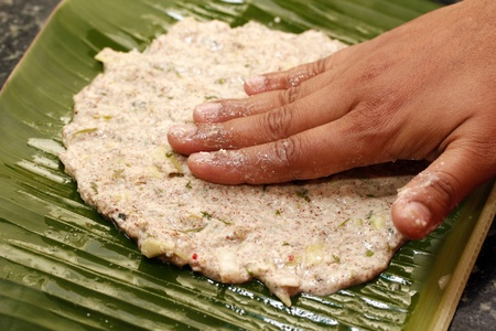 india food: Making process of indian bread on a plantain leaf Stock Photo