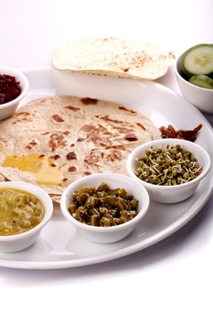 ghee: Indian lunch - chapatti, vegetables, sprouts and curries Stock Photo