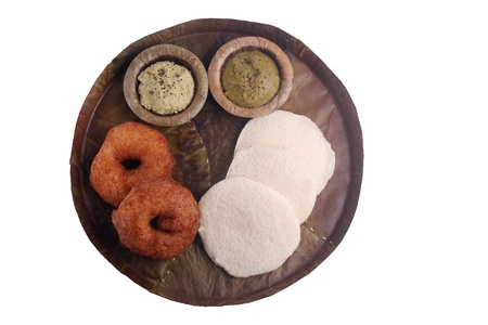 southern indian: Idly, medu vada and chutney on leaf plate - traditional south indian breakfast