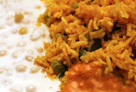 bean curd: Close up photo of biryani rice preparation and raitha