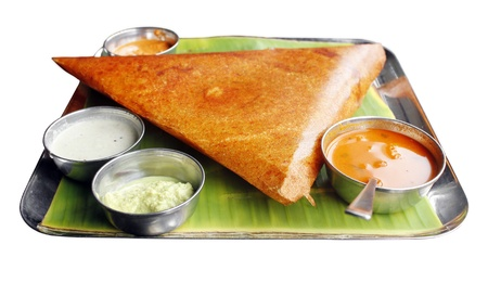 Masala dosa with different types of chutney and sambar. This is a closeup shot of one of the most famous indian snack.