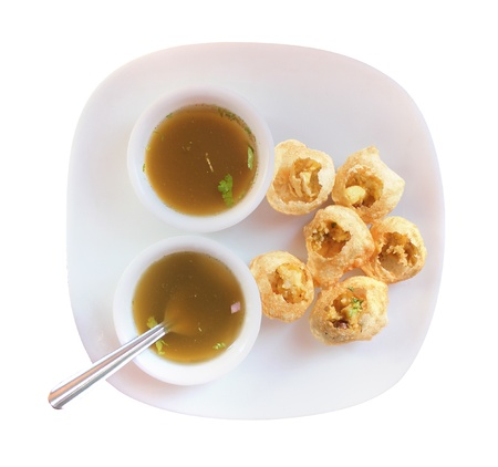pani: Panipuri snack also called gol gappa or phuchka - a famous indian delicacy isolated on white Stock Photo