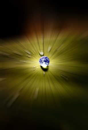 Planet earth waterdrop on leaf glowing in sunlight. Earth picture credit to: http:visibleearth.nasa.gov  photo