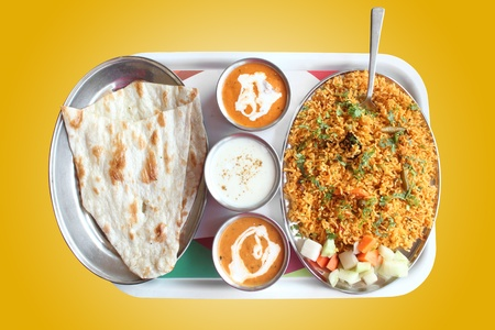naan: Indian biryani, butter naan with spicy curry and raitha on a plate with clipping mask Stock Photo