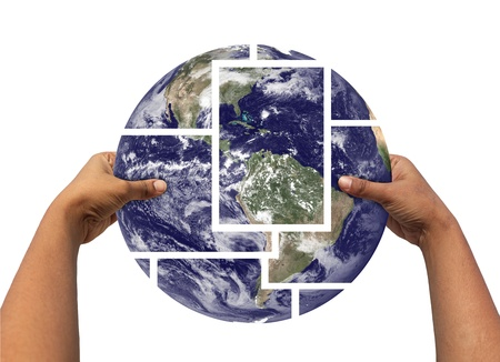 Woman assembling and holding earth photos partitioned and then joined again. Concept of saving earth. Earth photo credit - http:www.nasa.gov photo