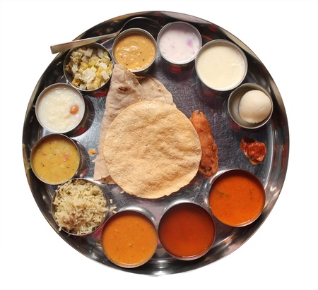 Indian plate meals with chapatti, rasam, sambar, dal and other curries photo