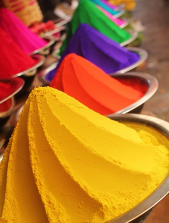 Colorful piles of powdered dyes used for holi festival on display in an indian shop at mysore photo
