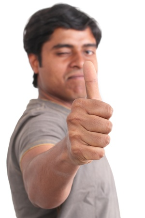 Portrait of happy young indian giving thumbs up over white background  photo