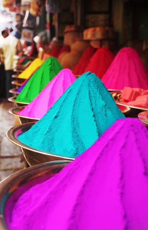 Colorful piles of finely powdered dyes used for hindu religious activities like holi on display in an indian shop at mysore market