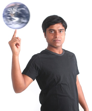 fingertip: Young person spinning world on his fingertip. World image courtesy: www.nasa.gov