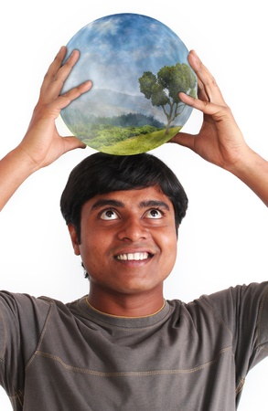 Person smiling and holding glowing ball containing ecosystem on the head  Concept of environment conservation  photo