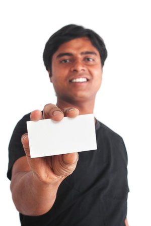 Young indian guy on isolated white background holding business card Stock Photo - 12772721