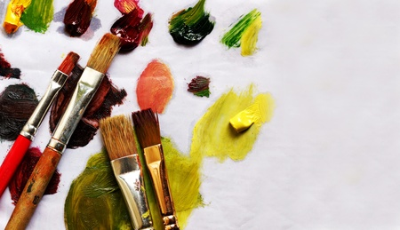 Paint brushes and different paint pigments on old paper with copy space Stock Photo - 12772764