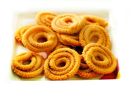 junkfood: Popular south indian deep fried snack called murukku or muruku  Stock Photo