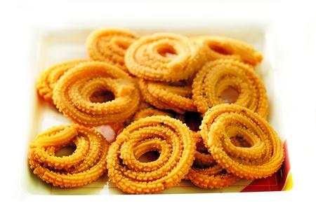 murukku: Popular south indian deep fried snack called murukku or muruku  Stock Photo