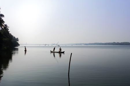 alappuzha: Kerala backwaters with people fishing near kochi and allepey early in the morning during pre-monsoon days. Stock Photo