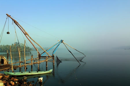 Kerala backwaters with chinese fishing net near kochi and allepey on a pre-monsoon day. photo