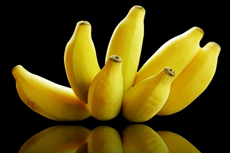 Bunch of banana fruits ripe isolated on black Stock Photo - 13493599