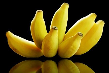 Bunch of banana fruits ripe isolated on black Stock Photo - 13493599