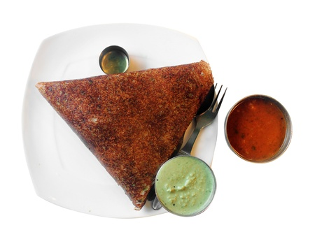 Masala dosa  - popular south indian breakfast served with chutney, sambar and ghee  Isolated on white  photo