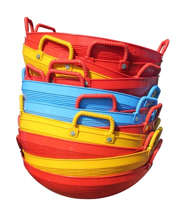 long lasting: New colorful plastic baskets isolated on white displayed for sale in a market