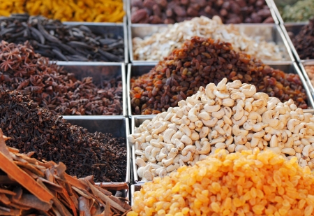 Dry fruits and spices like cashews, raisins, cloves, anise, etc. on display for sale in a bazaar in bangalore, india.  photo