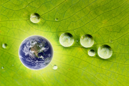 Concept of sustainable development, ecological conservation, protection of nature showing image of glowing earth and droplets of water. Earth image courtesy: www.nasa.gov photo