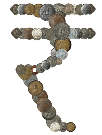 Indian rupee symbol created by arranging old, new and antique indian brass, copper, aluminium, silver, and other metal coins in newly introduced rupee shape over white background photo