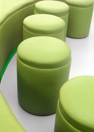 imitation leather: Photo of modern, comfortable, cushy and stylish stools for meeting rooms at office or living rooms at homes made with imitation leather in green color