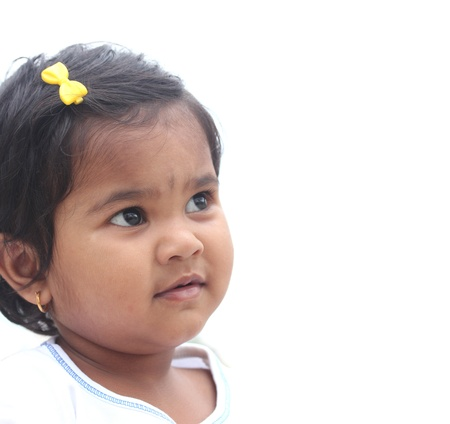 muslim baby girl: Photo of pretty and happy indian girl child. The picture can be used to show the baby day dreaming or the toddler imagining something or as a child with a vision, etc. The child is of pre-school age.