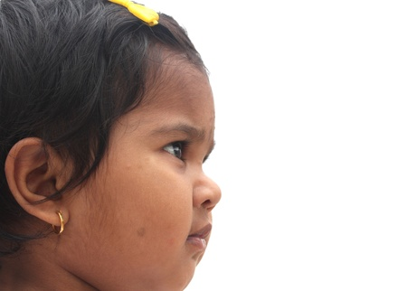 Photo of beautiful and charming happy indian girl child. The picture can be used to show the baby dreaming or the toddler imagining or as a visionary child, etc. The child is of pre-school age. photo