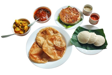 comprising: South indian morning breakfast and lunch comprising of dosa or uttapam, idli, poori, chutney, sambar and subzi isolated on white  Stock Photo