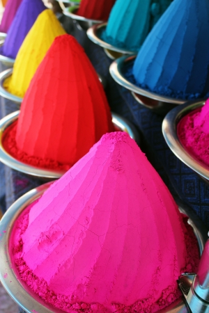 Piles and mounds of colorful dye powders for holi festival   other religious purposes commonly found in indian markets  These dry flour heaps were taken at mysore market   used mainly for rangoli  photo
