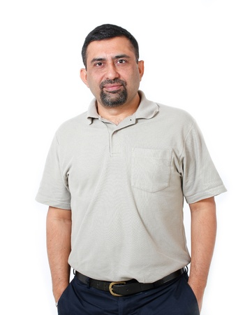 Close-up image of healthy, cool & happy asianindian executive with a smile. The person is wearing a casual T-shirt & the picture is shot in a studio and isolated on white