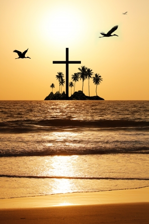 Majestic   heavenly seascape in the evening with island and a cross in the horizon  The evening sky is brightly lit by the setting sun with birds flying  The water waves are reflecting the sunlight photo
