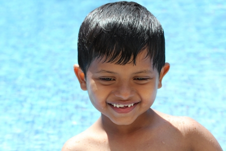 Happy young preschool kid boy  enjoying his time in a swimming pool Stock Photo - 16968733