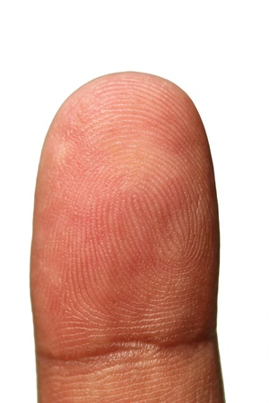 finger tip: Tip of human hand showing unique finger print lines as repeating patterns forming identity of a person  The photograph is isolated on white background with clipping path