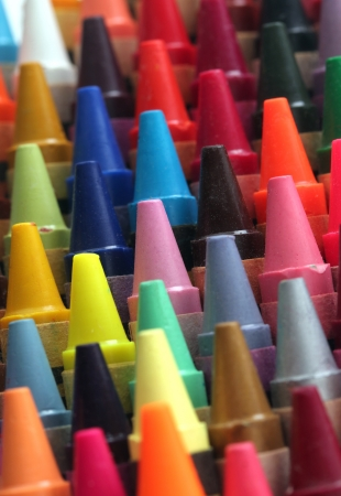 Colorful art wax crayon pencils tips for children and others\ arranged attractively in rows and columns making a stunning display\ of colors