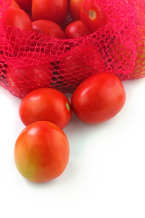 Fresh juicy organic tomatoes on white background. The fruits are ripe and bright red in color and ready for consumption photo