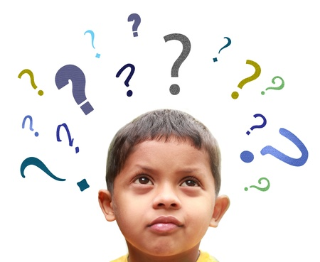 Young indian boy puzzled over many confusing questions without solutions about his friends, school, parents, food, play, etc. photo