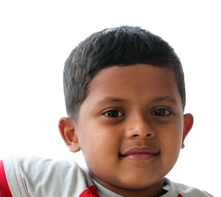 Handsome, intelligent &amp, smiling indian boy(kid) looking satisfied and content.   photo