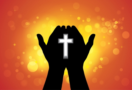 Person praying or worshiping with cross in hand - concept of a devout faithful christian worshiping Jesus Christ with yellow and orange background of stars and circles