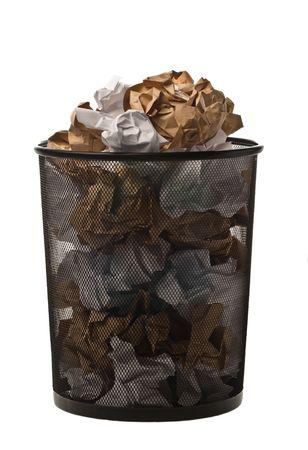 Filled up black metallic office trash basket isolated on white photo