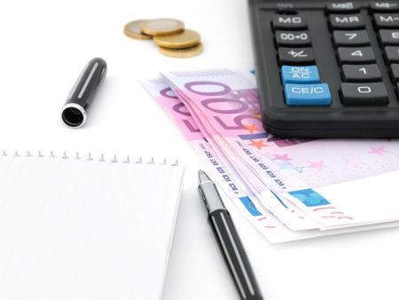 Blank notepad, pen, calculator and money photo