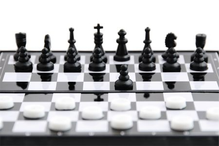 Black chess against white checkers on the board