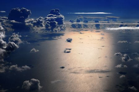 troposphere: Aerial view of sea and cumulus clouds at night