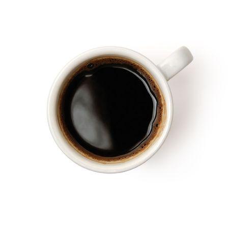 白い背景で隔離のコーヒーのカップの上から見る 写真素材