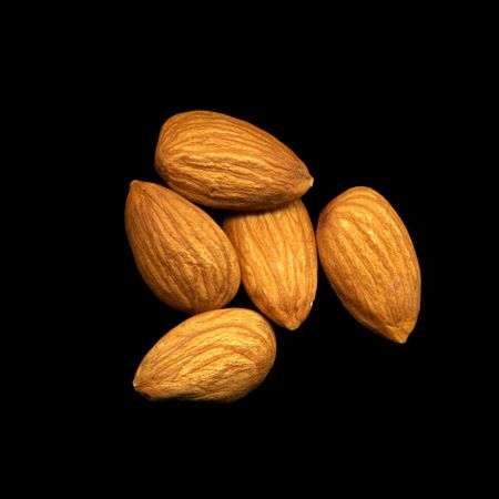 Peeled almonds isolated on black background Stock Photo - 6636051