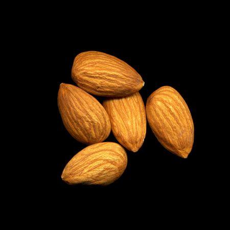 Peeled almonds isolated on black background Stock Photo - 6636051